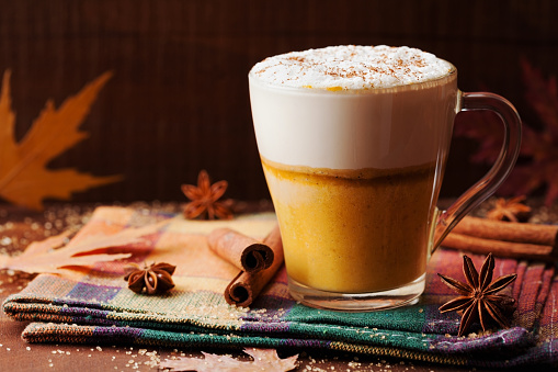 istock Pumpkin spiced latte or coffee. Autumn or winter hot drink. 597259590