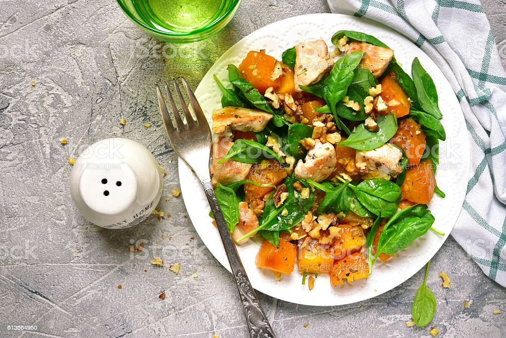 Pumpkin stew with chicken,spinach and walnuts.Top view. – Foto