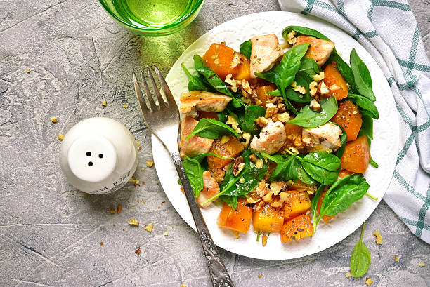 Pumpkin stew with chicken,spinach and walnuts.Top view. stock photo