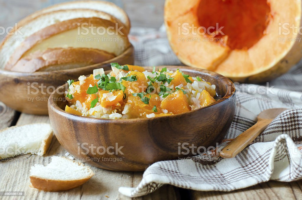 Pumpkin stew with rice and meat stock photo