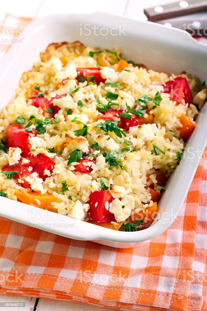 Pumpkin, tomato and fetta risotto stock photo