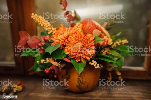 Pumpkin with a beautiful bouquet of autumn flowers inside picture id1008908748?b=1&k=6&m=1008908748&s=612x612&h=narjtr3f0z3haeya dzbfgbavklez3mmqqpchzjrexy=