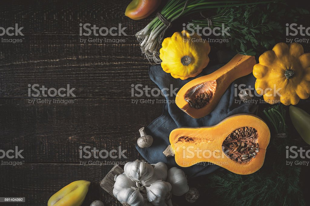 Pumpkin with different vegetables  at the right of wooden table – Foto