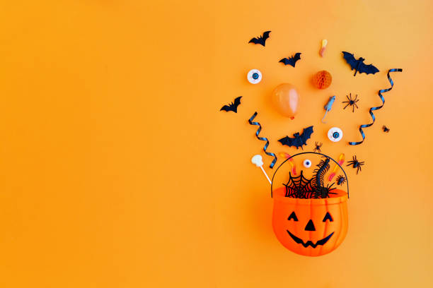 Pumpkin with Halloween objects stock photo