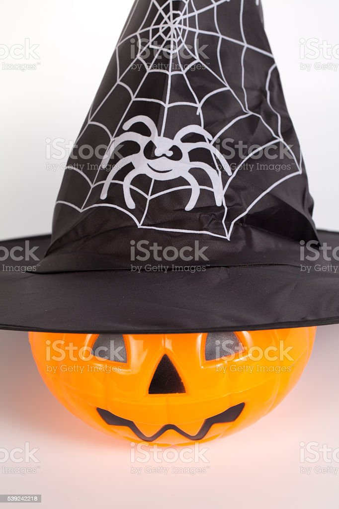 Pumpkin with halloween phrases with wizard Hat on white backgrou royalty-free stock photo