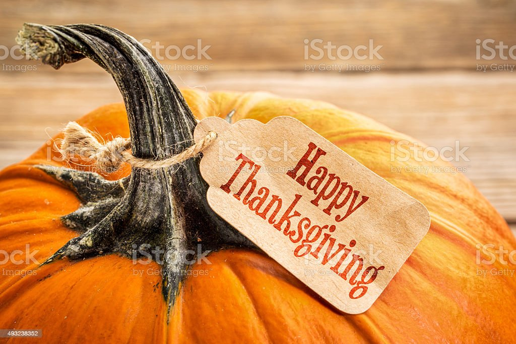 pumpkin with Happy Thanksgiving  tag stock photo