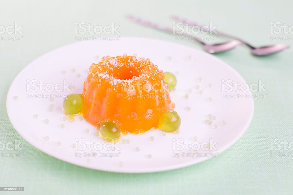 Pumpkin-ginger jelly with mint spheres and caviar stock photo