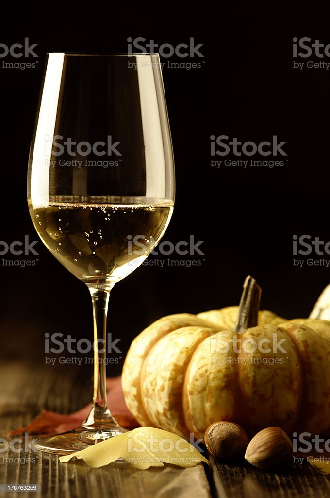 Pumpkins and autumn leaves with white wine royalty-free stock photo