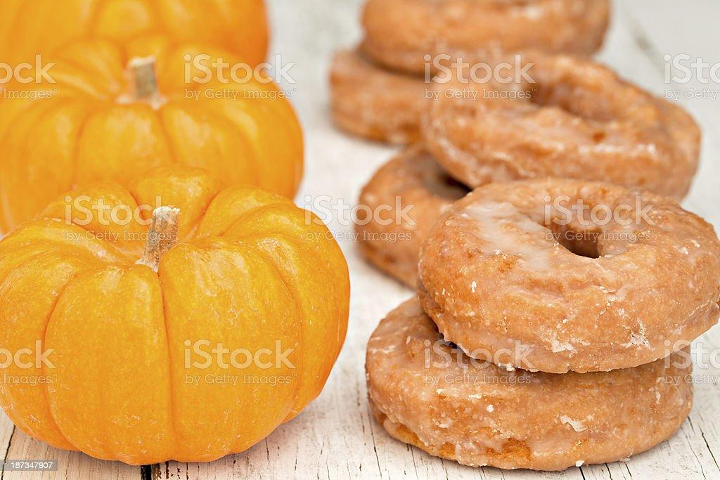 Pumpkins And Doughnuts stock photo