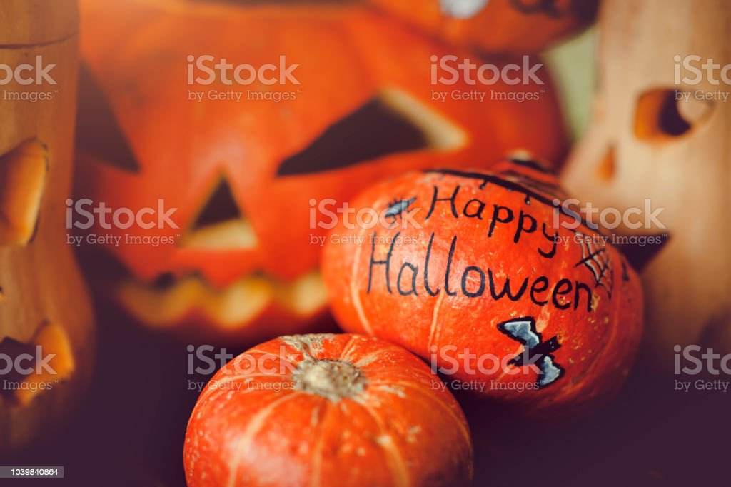 Pumpkins and jack o' lanternon the table stock photo