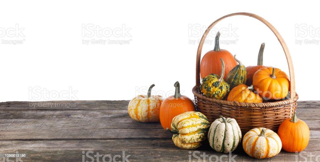 Pumpkins in basket stock photo