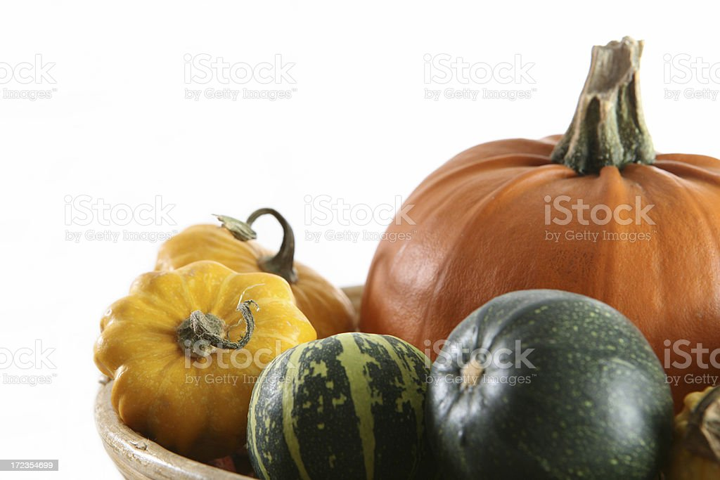 pumpkins in basket royalty-free stock photo