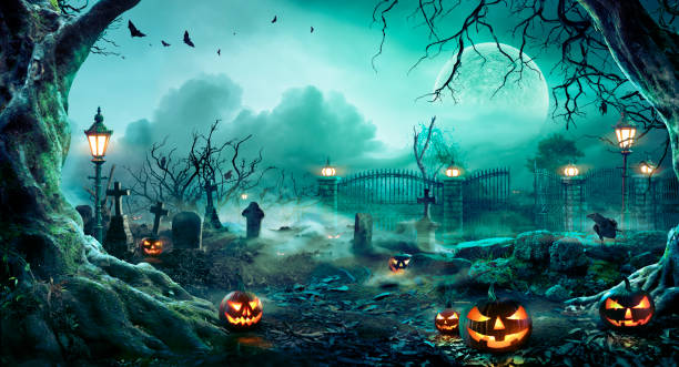 Pumpkins In Graveyard In The Spooky Night - Halloween Backdrop stock photo