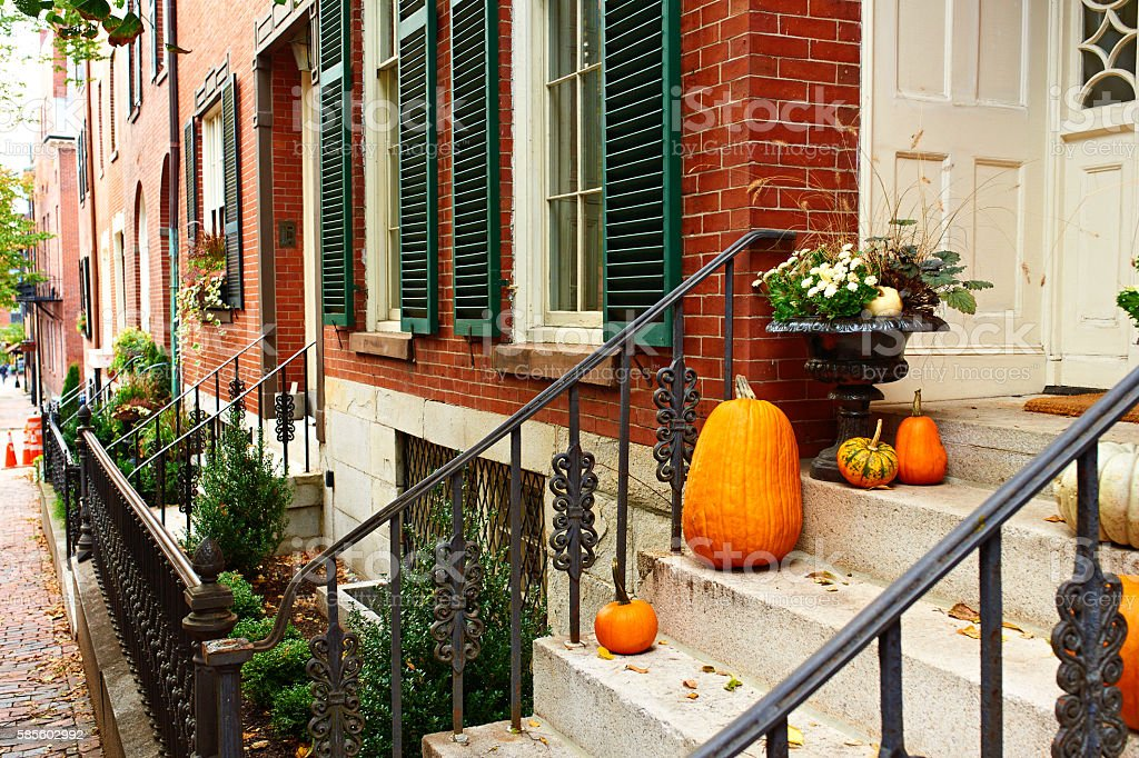 Pumpkins near the door for Halloween stock photo