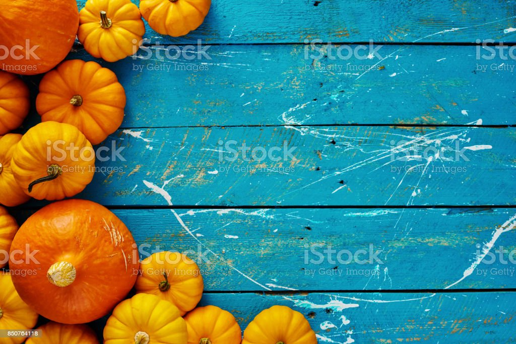 Pumpkins on blue table stock photo