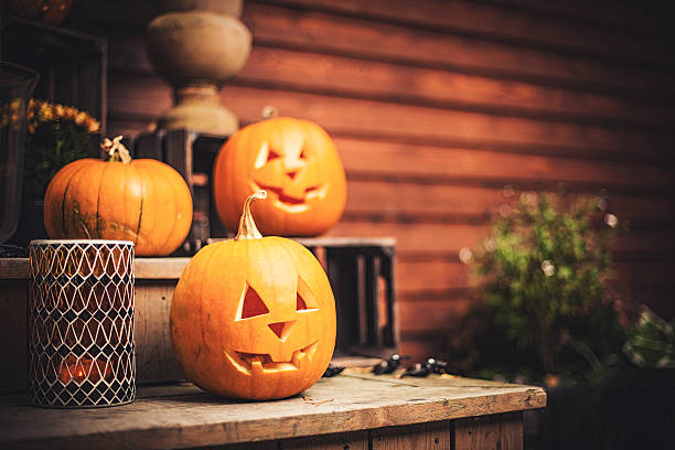 Pumpkins on front step with halloween decorations stock photo