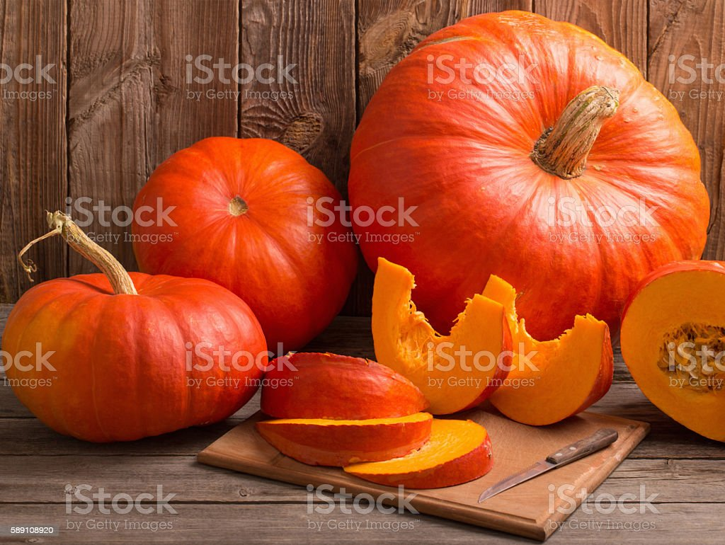 pumpkins on wooden board stock photo