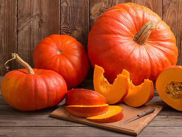 pumpkins on wooden board - pumpkin stock photos and pictures
