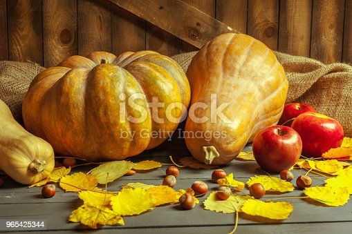Pumpkins On Wooden Board Stock Photo & More Pictures of Autumn