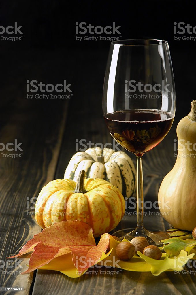 Pumpkins, wine and autumn leaves royalty-free stock photo