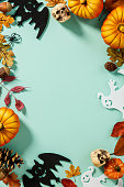 istock Pumpkins with Halloween decorations - overhead view flat lay 1221348671