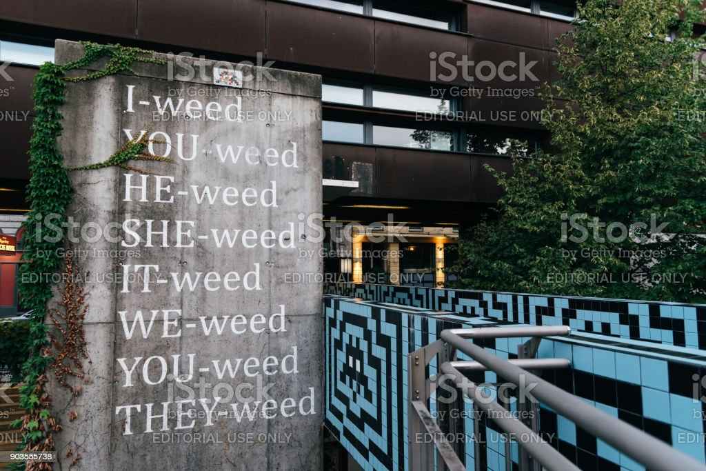 Pun with the word weed on concrete wall in Vienna stock photo