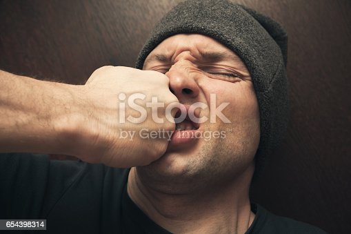istock Punch in the face, street fight 654398314