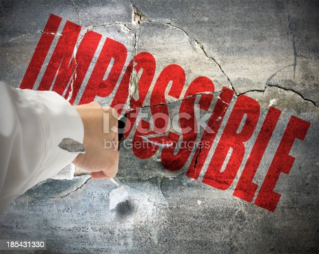 istock Punching ,break concrete wall with word