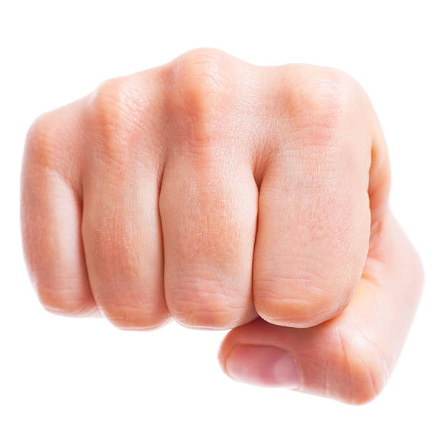 punching fist - fist stock photos and pictures