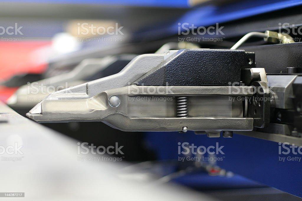 Punching machine gripper mechanism stock photo