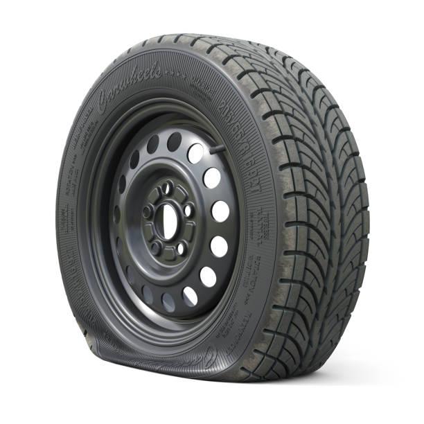 geperforeerde auto wiel geïsoleerd op witte achtergrond - tyre stockfoto's en -beelden