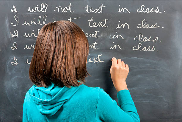 Punished for texting in class. stock photo