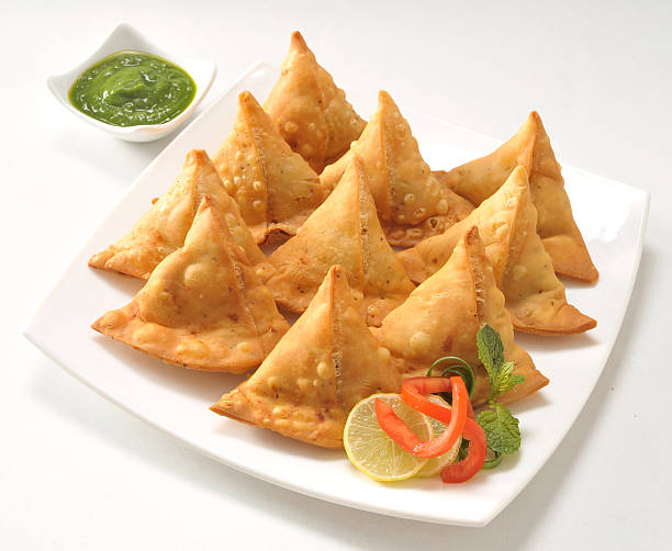 punjabi samosa with chutney - samosa stock photos and pictures