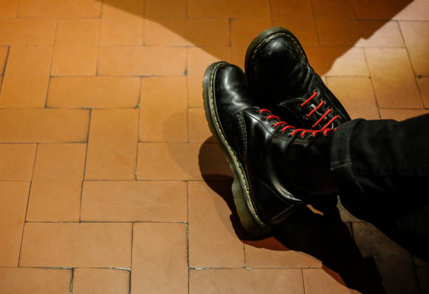 punk black boot - punk music stock photos and pictures