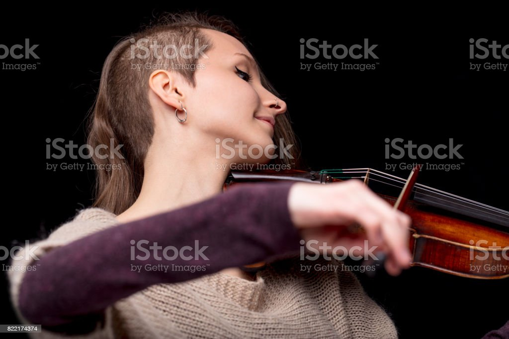 punk folk violinist woman smiling and playing stock photo