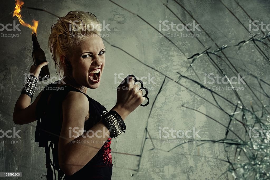 Punk girl behind broken glass stock photo