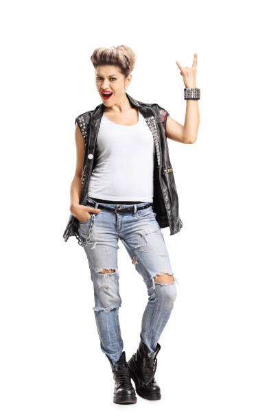 Punk girl making a rock hand gesture stock photo