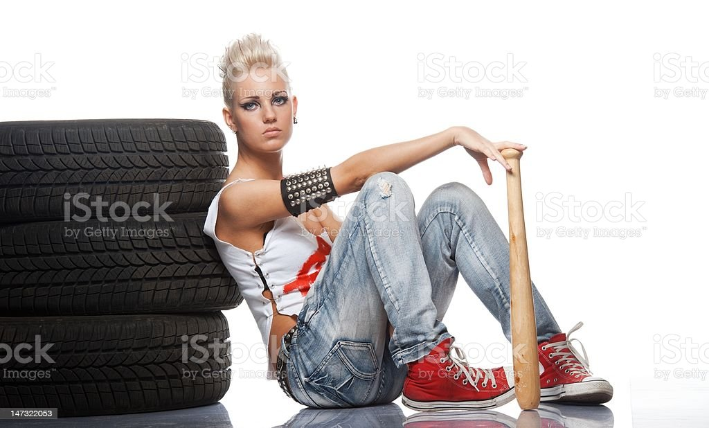Punk girl with a bat sitting royalty-free stock photo