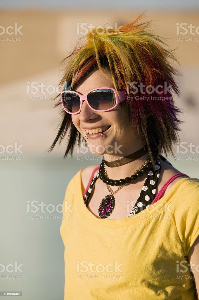 Punk Girl with Bright Colorful and Big Sunglasses royalty-free stock photo