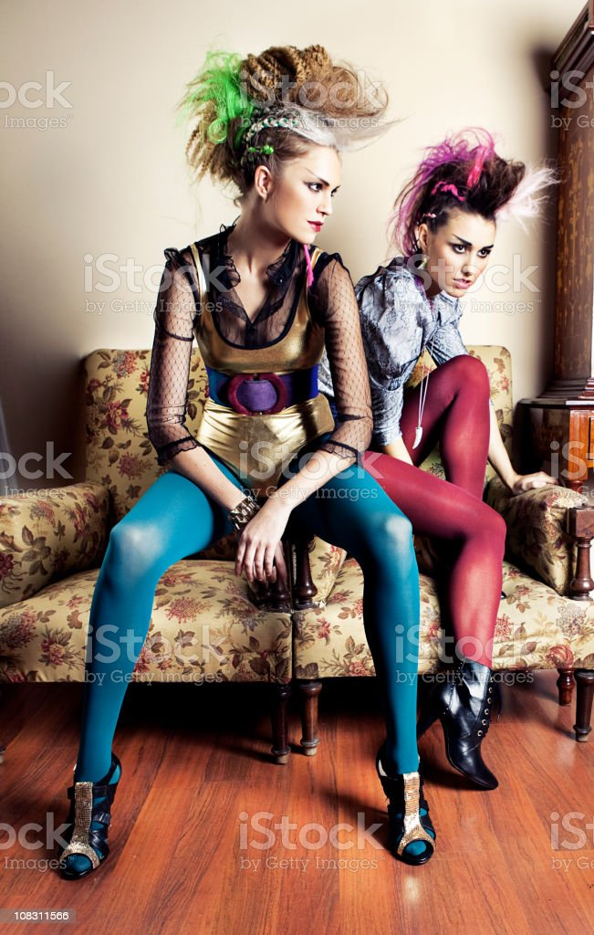 Punk girls in a retro living room stock photo