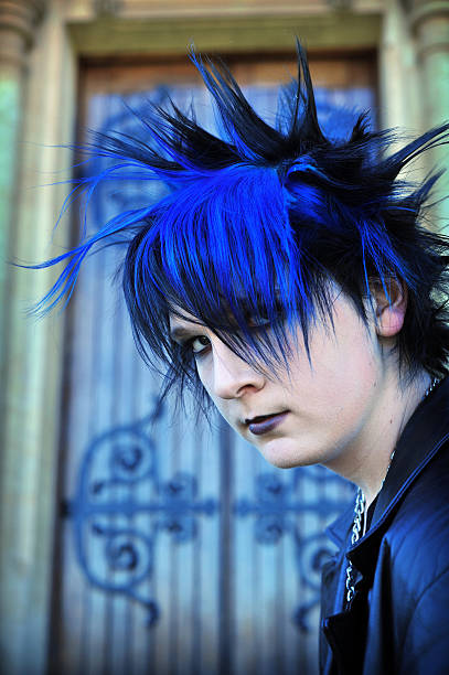 Punk Goth Boy Goth Punk boy in front of gothic church door with blue and black hair goth stock pictures, royalty-free photos & images