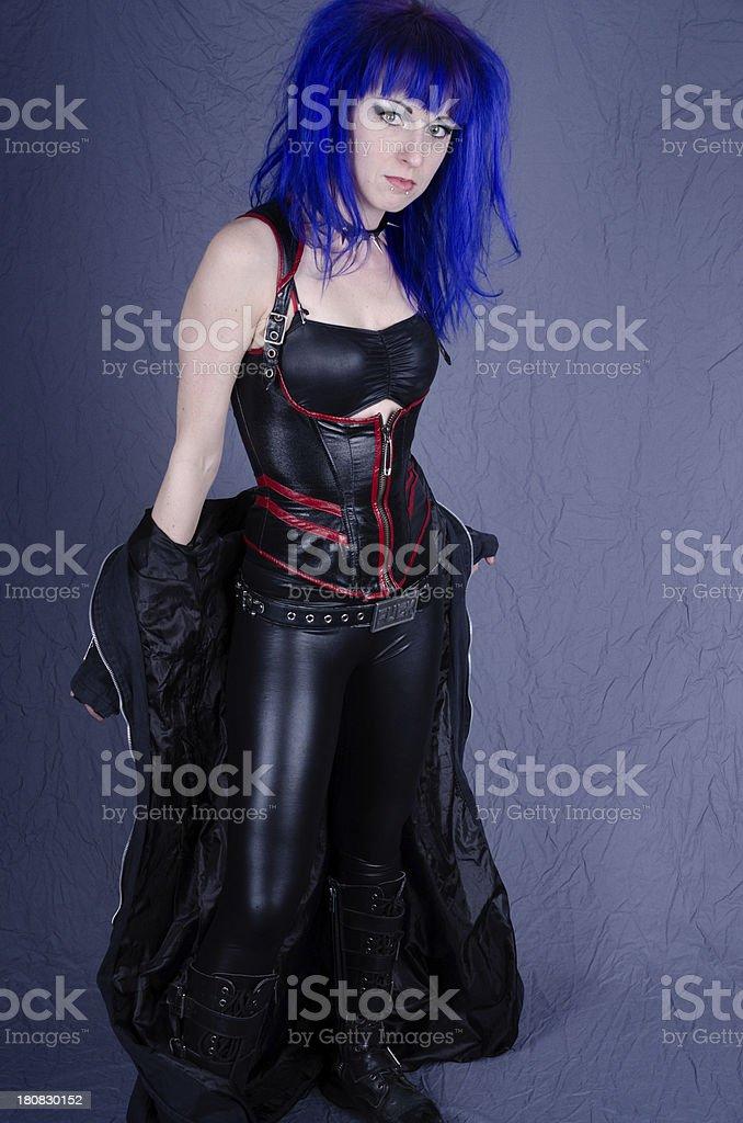 Punk goth woman dropping long coat. royalty-free stock photo
