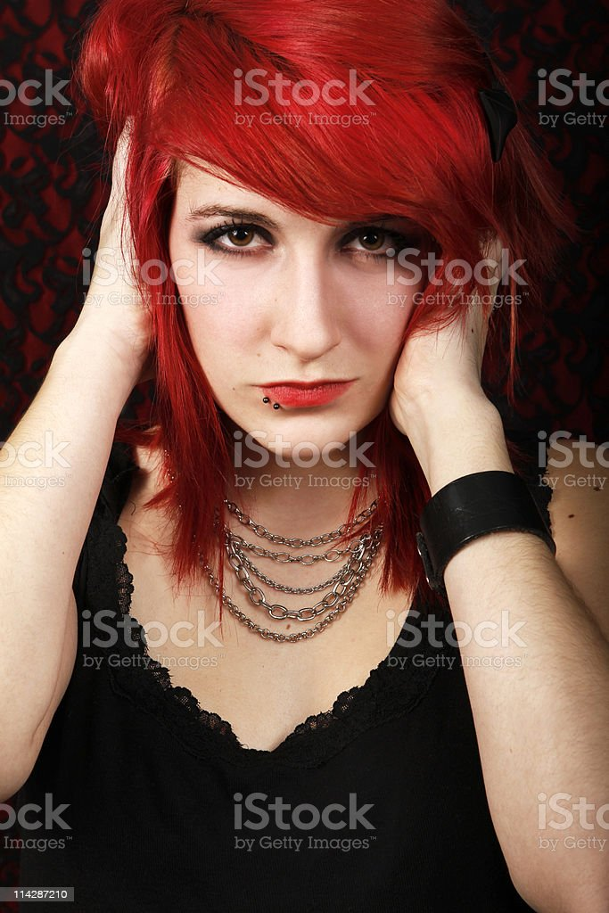 Punk red hair girl with piercings royalty-free stock photo