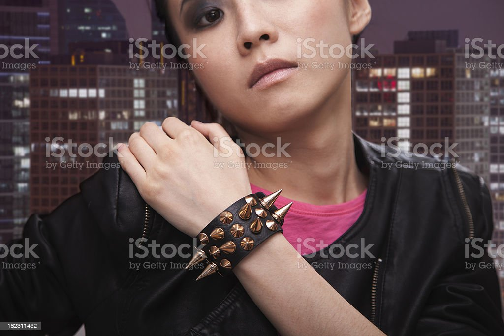Punk Rock Girl in front of Cityscape stock photo