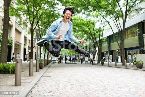 istock punk rocker jumping in Tokyo 608617360