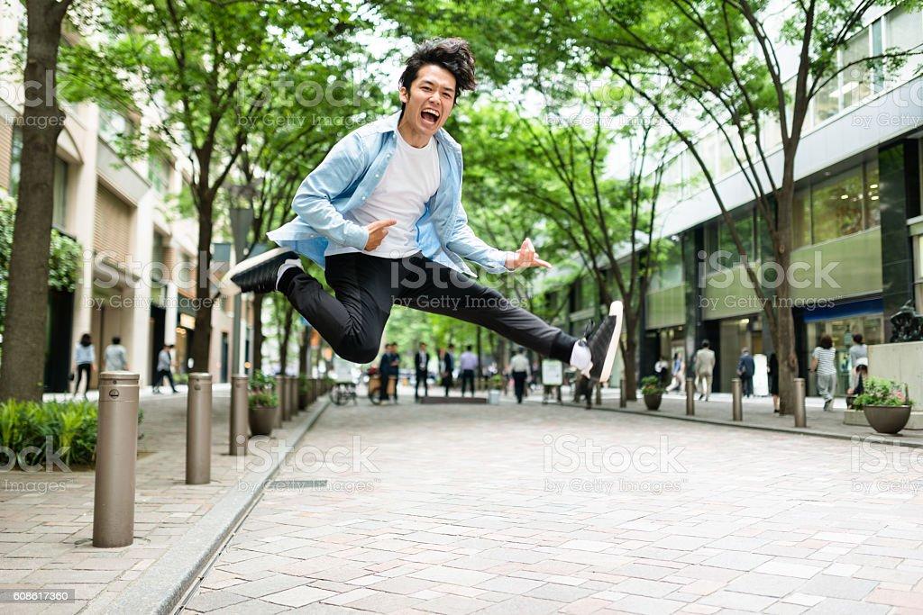 punk rocker jumping in Tokyo stock photo