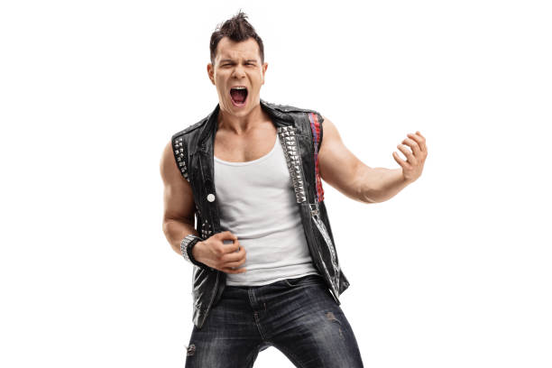 punk rocker playing air guitar - punk music stock photos and pictures