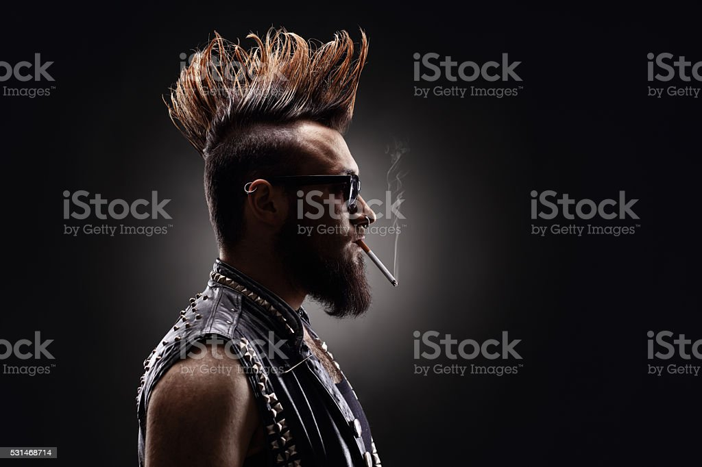 Punk rocker smoking a cigarette stock photo