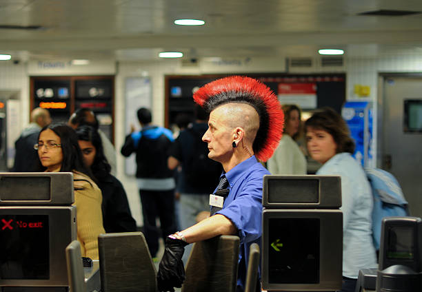 Punk Ticket Inspector on the London Underground stock photo