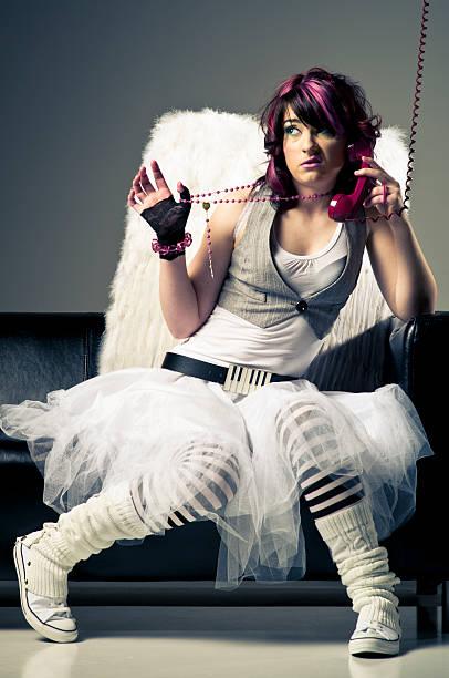 Punk Woman Wearing Angel Wings stock photo